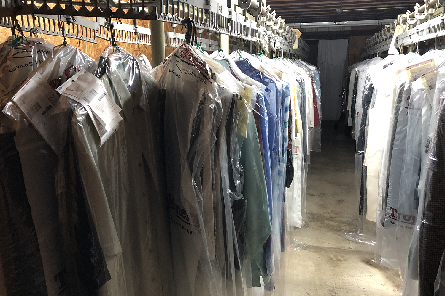 Photo of several articles of clothing that have been cleaned and hung for pickup.